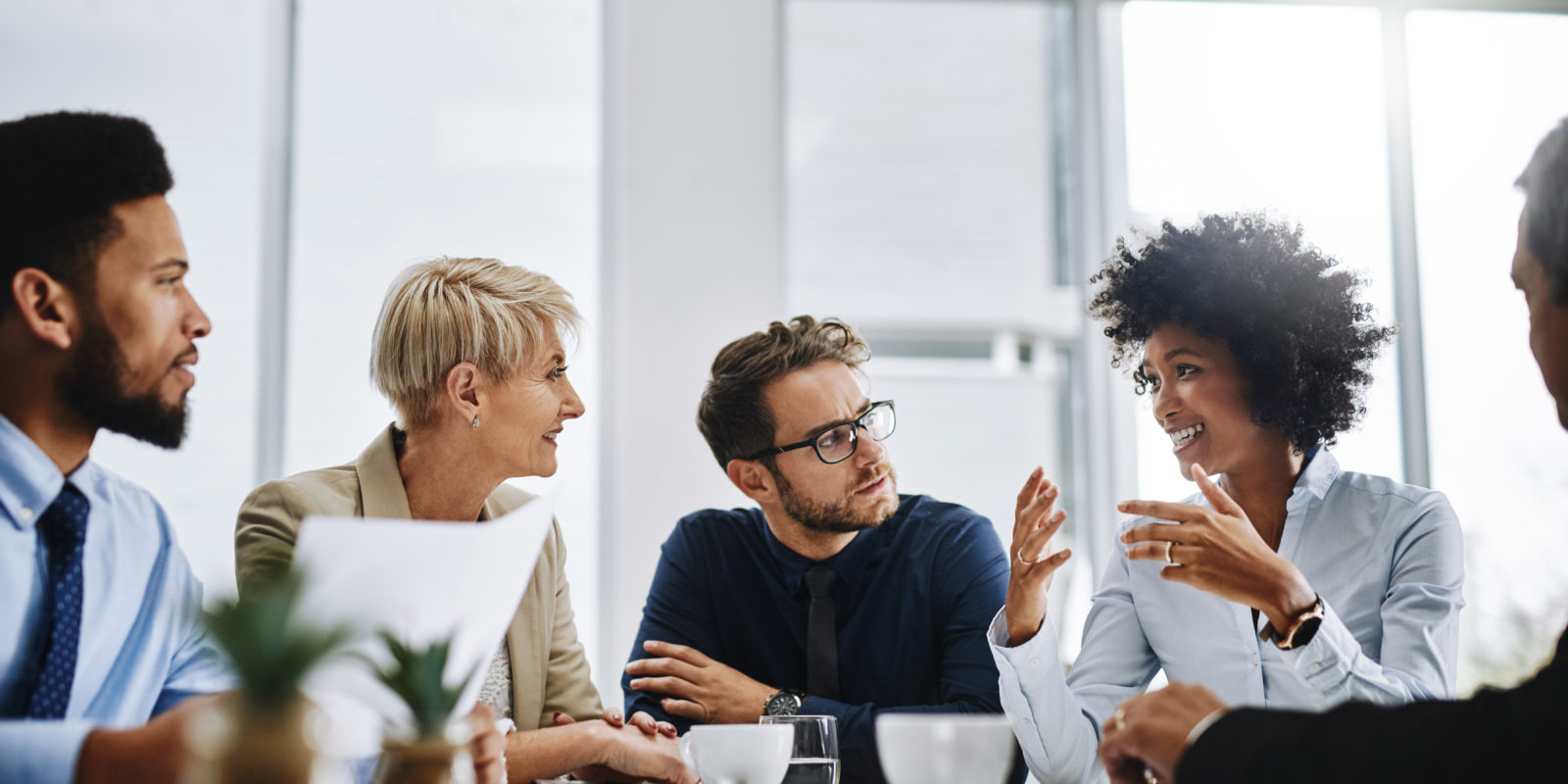Shot of a group of business people sitting together in a meeting