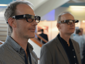 Andy Hird Managing Director of ALigned Assets wearing Optinvent's Ora-2 smart glasses